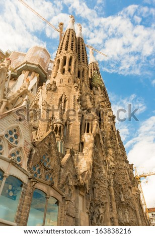 BARCELONA SPAIN - OCTOBER 10: La Sagrada Familia - the cathedral designed by Gaudi, which is being build since 19 March 1882 and is still under construction as of October 10, 2013 in Barcelona, Spain. - stock photo