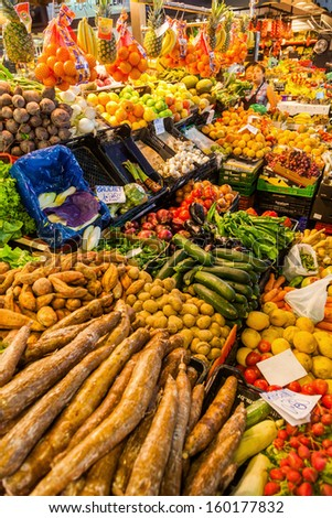 BARCELONA, SPAIN - OCTOBER 14: market stall in the market hall La Boqueria with unidentified people on October 14, 2013 in Barcelona. It is a famous and historical market hall on 2.600 square meters. - stock photo