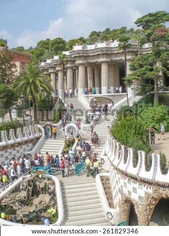 BARCELONA, SPAIN - OCTOBER 1, 2008: Tourist visiting the Parc Guell designed by Gaudi