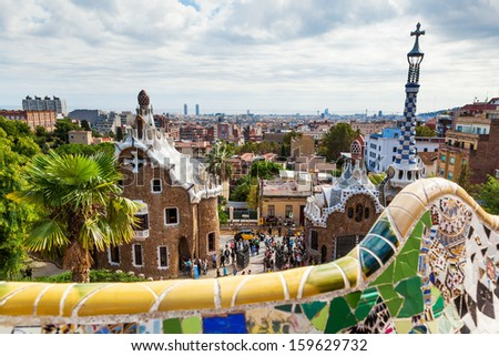 BARCELONA, SPAIN - OCTOBER 12: view of the famous Park Guell with unidentified people on October 12, 2013 in Barcelona. The Park, designed by Antoni Gaudi is part of the UNESCO world heritage sites