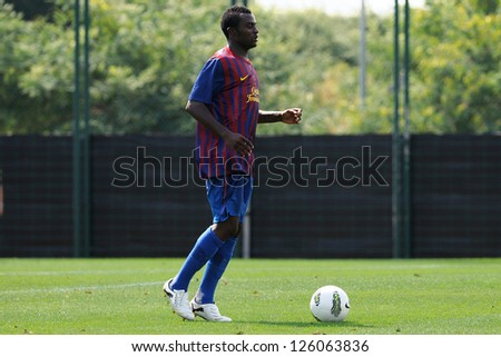 BARCELONA, SPAIN - SEP 11: Vivaldi Leonid Bakoyok Bako plays with F.C Barcelona youth team against Manlleu on September 11, 2011 in Barcelona, Spain. - stock photo