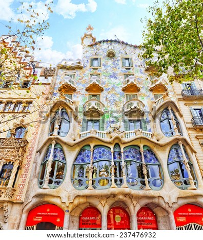 BARCELONA, SPAIN - SEPT  04, 2014: Outdoor view  Gaudi's  creation-house Casa Batlo. was built in 1877 by Antoni Gaudi.   September 04, 2014 in Barcelona, Spain. - stock photo