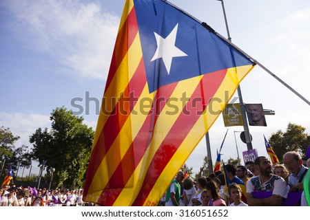 BARCELONA, SPAIN - SEPTEMBER 11, 2015: Catalan pro-independence people during the Catalonia National Day in Barcelona. They demand the right to vote for the independence of Catalonia. - stock photo