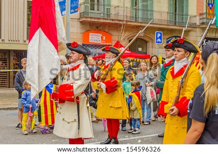 BARCELONA, SPAIN - SEPTEMBER 11: Catalonia people in historic attire participate in parade during the National Day of Catalonia, Barcelona, Spain on September 11, 2013