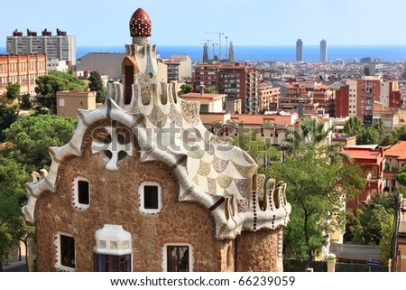 "BARCELONA, SPAIN-SEPTEMBER 28: Famous building at the entrance of Park Guell,designed by Gaudi,on September 28,2010.Part of the UNESCO World Heritage Site ""Works of Antonio Gaudi""."
