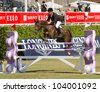 BARCELONA, SPAIN - SEPTEMBER 23: Leon Thijssen from Netherlands in action during the CSIO 100th International Jumping Competition, on September 23, 2011, in Real Club de Polo, Barcelona, Spain. - stock photo