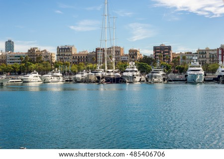 BARCELONA, SPAIN - SEPTEMBER 15. Luxury yachts moored in the marina Port Vell in Barcelona on September 15, 2016. The city is an important destination. Some yachts are to rent for incredible money