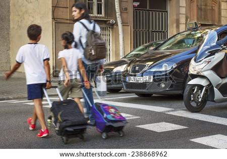 BARCELONA, SPAIN - SEPTEMBER 19, 2014. On a pedestrian crossing in Barcelona on 19.09. 2014. - stock photo
