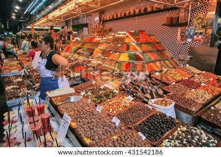 BARCELONA, SPAIN - SEPTEMBER 04, 2015: People buying food inside Mercat de Sant Josep de la Boqueria. It is a large public market in the Ciutat Vella district of Barcelona. - stock photo
