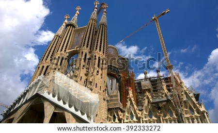 BARCELONA, SPAIN - SEPTEMBER 19: Sagrada Familia in Barcelona, Spain on September 19, 2015. Basilica and Expiatory Church designed by Gaudi, is being build since 1882 and is still under construction. - stock photo