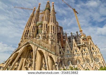 BARCELONA, SPAIN - SEPTEMBER 3: Sagrada Familia on September 5, 2012 in Barcelona, Spain. This cathedral was designed by famous spanish architect Antoni Gaudi and hadn't been finished till nowadays. - stock photo