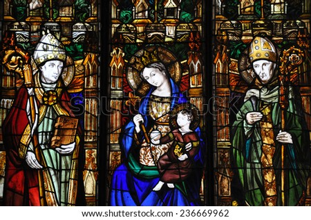 BARCELONA, SPAIN - SEPTEMBER 5, 2012: Stained glass window depicting the Virgin Mary holding baby Jesus and two apostles, Palau de la Generalitat (City Hall), Gothic Quarter, Barcelona - stock photo