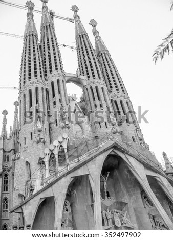 BARCELONA, SPAIN - SEPTEMBER 30, 2008: The construction of La Sagrada Familia church designed by Gaudi started in 1882 and is still unfinished in black and white - stock photo