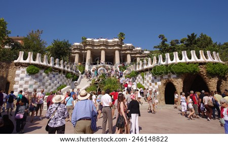 BARCELONA, SPAIN - SEPTEMBER 28, 2011: Tourists visits Parc Guell in Barcelona, Spain. The park is designed by Antoni Gaudi, photo taken on September 28, 2011 in Barcelona.  - stock photo
