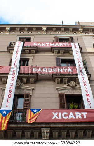 "BARCELONA, SPAIN. SEPTEMBER 11: Unidentified Catalonian citizens show they support to the Catalunya Independence on 11/September/2013 during the ""Diada"" celebrations in Barcelona."