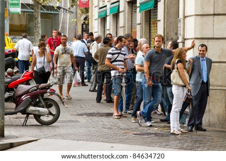 BARCELONA, SPAIN - SEPTEMBER 5: Unidentified people do a queue to buy tickets for the last bullfighting of Jose Tomas in Catalonia before the prohibition, on September 5, 2011, in Barcelona, Spain.