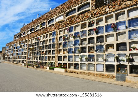 BARCELONA, SPAIN - SEPTEMBER 19: View of Montjuic Cemetery on September 19, 2013 in Barcelona, Spain. The cemetery contains over one million burials and cremation ashes in its 567,934 meters square - stock photo