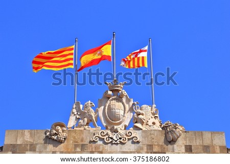 Barcelona Town Hall with Spain and Catalan flags under the blue sky, Barcelona, Catalonia, Spain - stock photo