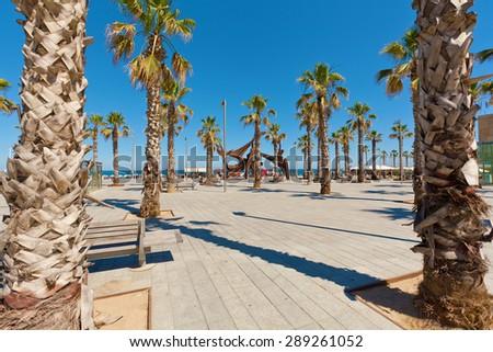 Barceloneta beach in Barcelona, Spain. View of the beach of Barceloneta. - stock photo
