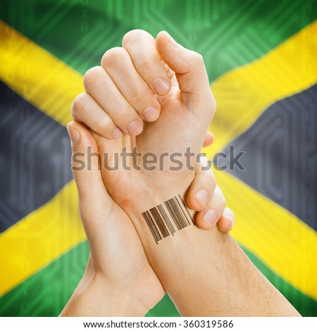 Barcode ID number on wrist of a human and national flag on background series - Jamaica - stock photo
