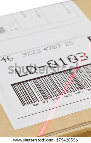 Barcode on shipping label on box scanned by automatic laser scanner - stock photo