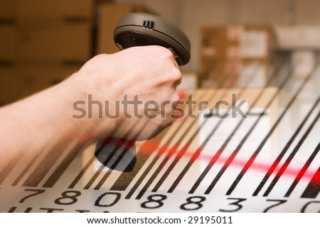 Barcode scanner and label with red laser beam. Warehouse concept. - stock photo