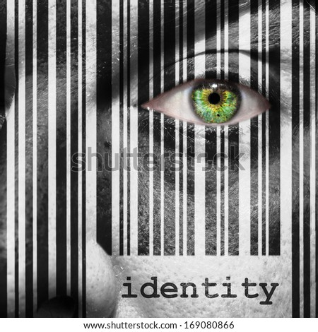 Barcode with the word identity as concept superimposed on a man's face - stock photo