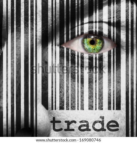 Barcode with the word trade as concept superimposed on a man's face - stock photo