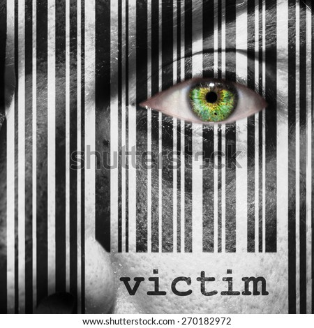 Barcode with the word victim as concept superimposed on a man's face