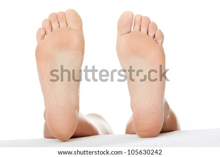 Bare feet isolated on the white background. - stock photo