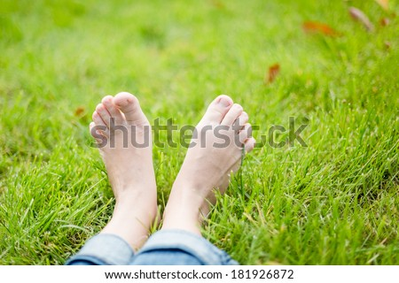 bare feet on green grass, copy space