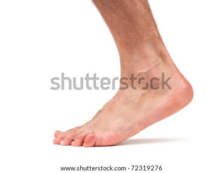 Bare male foot walking - stock photo