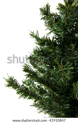 Bare plastic christmas tree in closeup over white background
