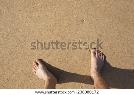 barefeet in sand on beach in summer holidays relaxing - stock photo