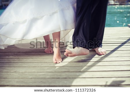 Barefoot Bride and Groom - stock photo