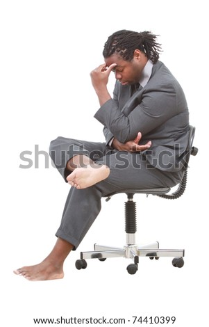 Barefoot businessman on a chair - stock photo