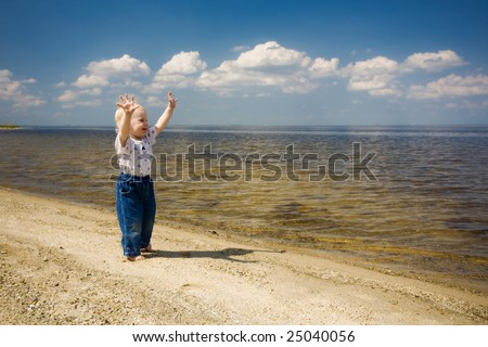 barefoot child is happy on the river bank