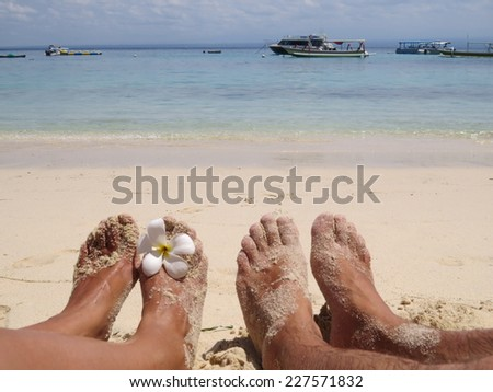 Barefoot in white sand at the beach in Gili Meno, Lombok, Indonesia - stock photo