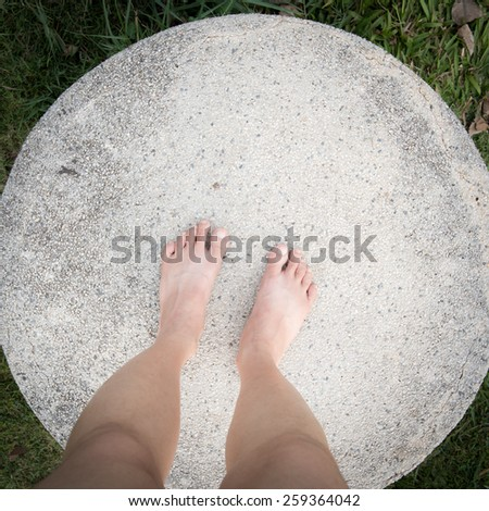 barefoot on patterned paving tiles, cement brick floor background