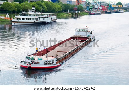barge and boat on the river - stock photo