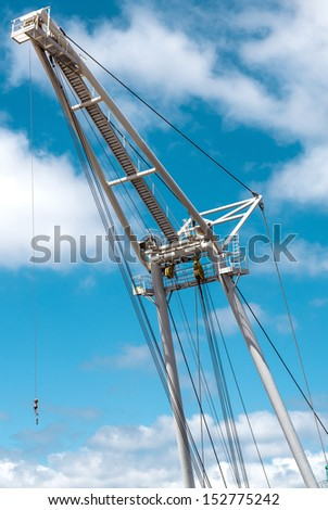Barge crane over blue sky background - stock photo