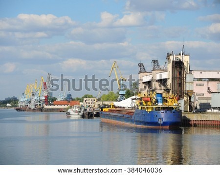 Barge during the loading of the Elevator - stock photo