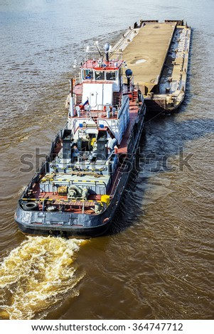 barge loaded with sand on the river - stock photo