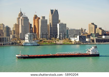 Barge on the Detroit river - stock photo