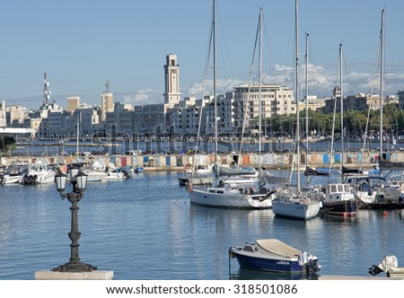 BARI, ITALY - JULY 11: view from the sea of Bari town with Clock Tower of Palace Province. Shot in 2014 - stock photo