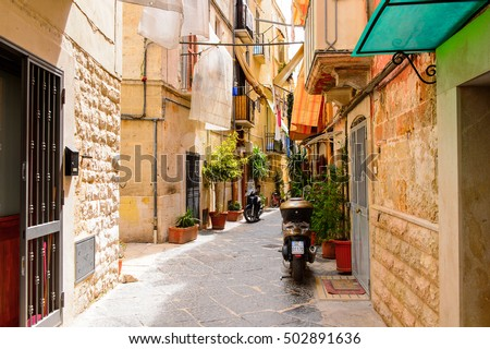 BARI, ITALY- MAY 9, 2016: Narrow street in  the Old Town of Bari, Italy. Bari is the capital Apulia region, on the Adriatic Sea