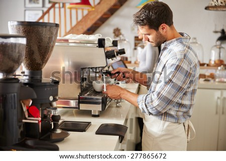 Barista at work in a cafe - stock photo