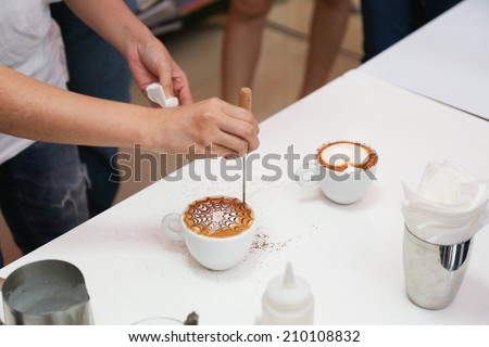 Barista making a cup of beautiful latte art coffee - stock photo
