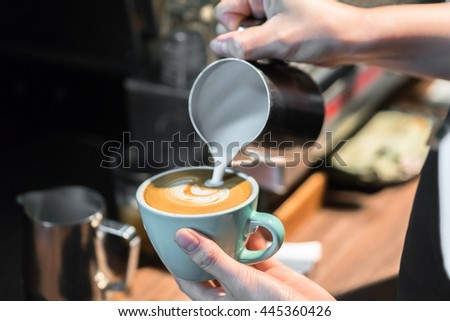 Barista making fresh coffee latte  - stock photo