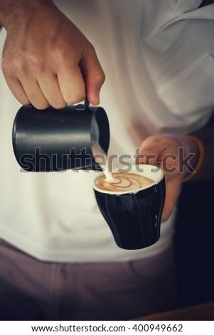 barista making latte in retro filter effect - stock photo